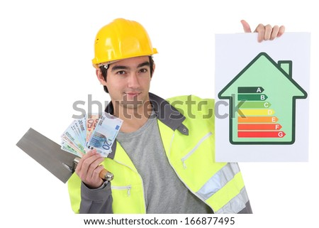 Tradesman holding up money - stock photo