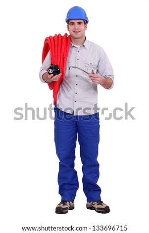 Tradesman installing a water system - stock photo