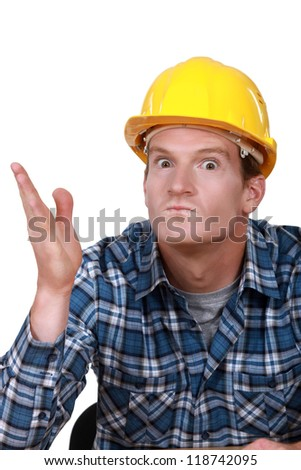 Tradesman looking ready to hit somebody - stock photo