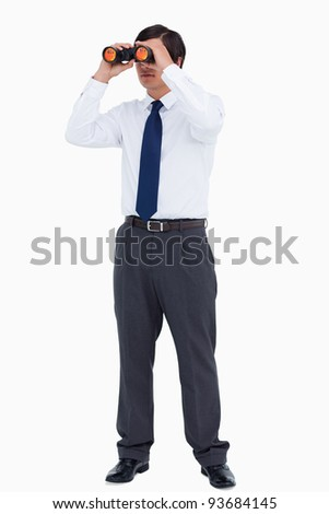 Tradesman looking through spy glass against a white background - stock photo