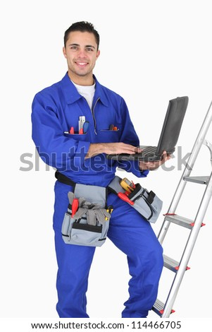 Tradesman posing with his tools - stock photo