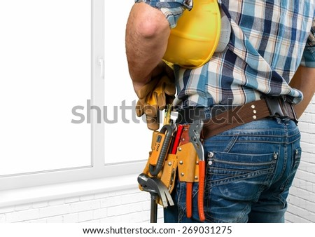 Tradesman, toolbelt, woman.