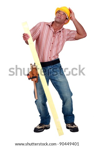 Tradesman trying to protect himself from falling debris - stock photo