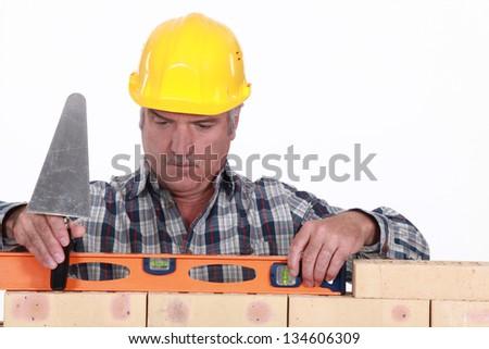 Tradesman using a level - stock photo