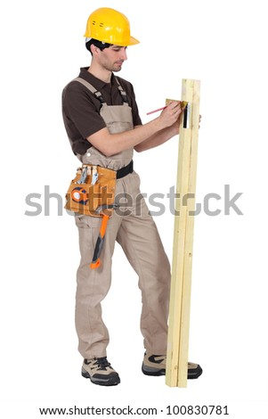 Tradesman using a try square to measure an angle - stock photo