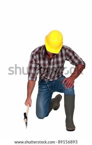 Tradesman using an axe - stock photo