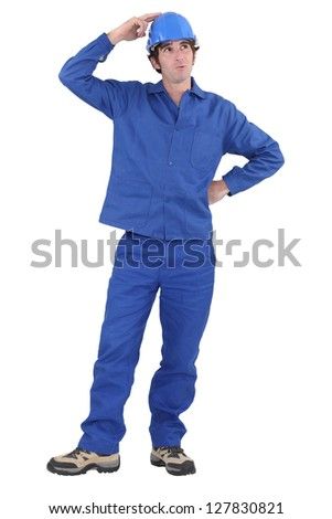 Tradesman with a dreamy look on his face - stock photo