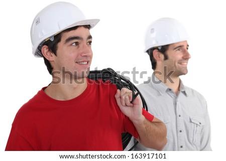 Tradesmen looking sideways - stock photo