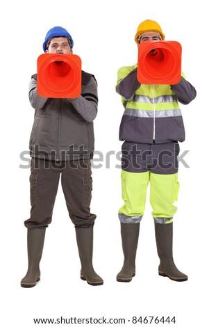 Tradesmen using pylons as megaphones - stock photo