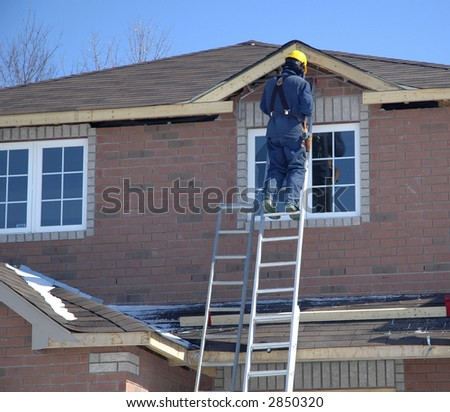 Tradesperson working on a new home. - stock photo