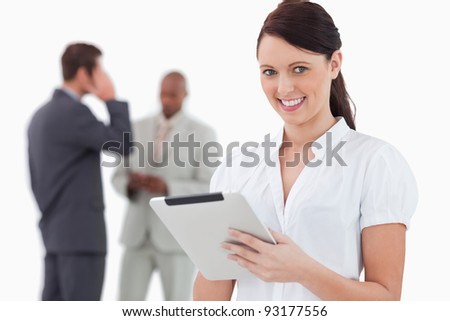 Tradeswoman with tablet and associates behind her against a white background