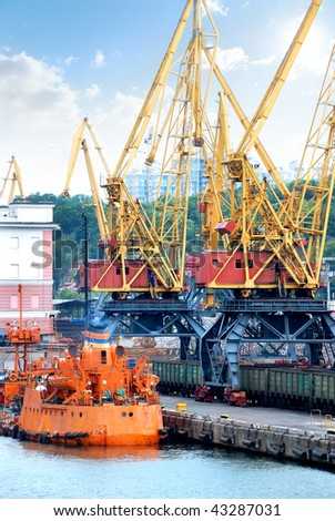 Trading port with cranes - stock photo