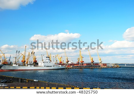 Trading port with cranes and cargo ship