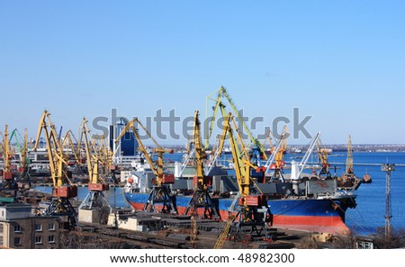 trading port with cranes and cargo ships