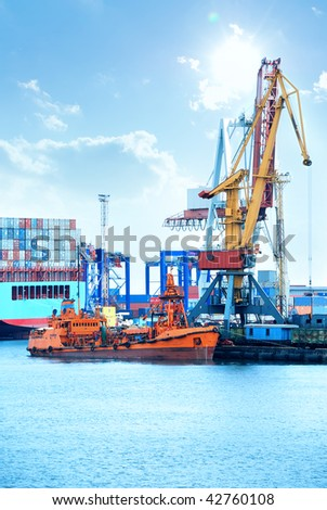 Trading port with cranes, containers and cargo ship - stock photo