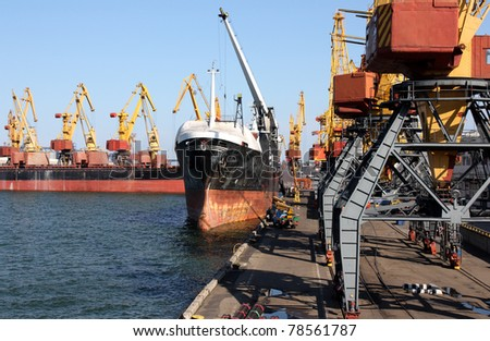 trading seaport with cranes and cargo ships