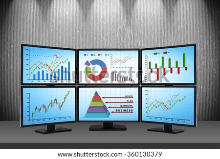 trading station which consists of four screens with financial data - stock photo
