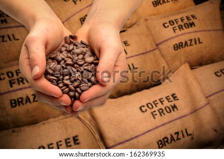 Trading with coffee beans - stock photo
