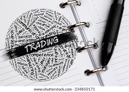 TRADING word concept written on notebook - stock photo