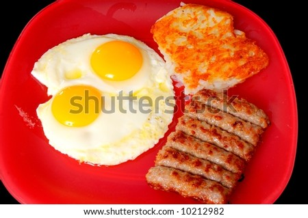 Tradition breakfast of eggs, sausage, and hash brown potatoes - stock photo