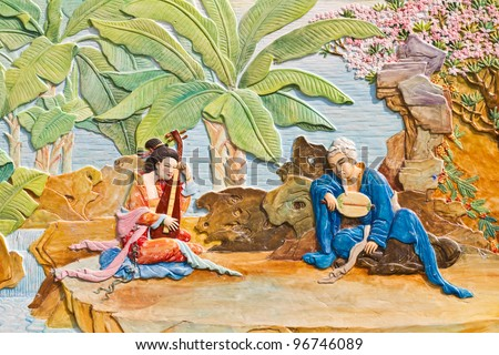 Tradition Chinese painting on Chinese temple wall. - stock photo