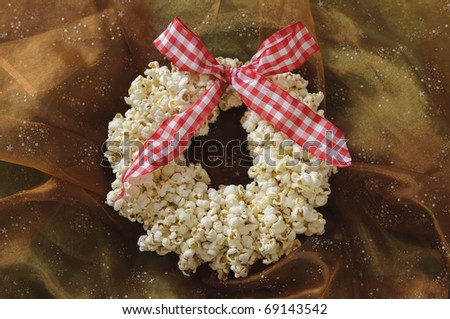 Tradition christmas wreath made of popcorn with red and white ribbon - stock photo