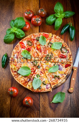 Tradition spanish pizza with chili and jalapenos - stock photo