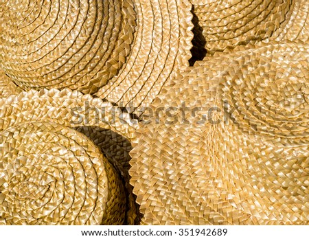 Tradition straw hat in Ukraine. Straw sun hats closeup - wicker texture for your background in folk style. - stock photo