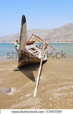 Tradition Wooden Boat on a Dubai Beach - stock photo