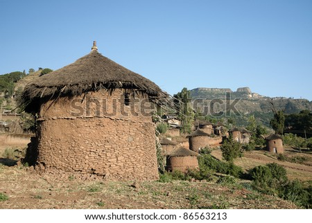 traditional african adobe mud homes in lalibela ethiopia - stock photo
