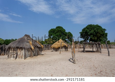 Traditional african village with housed and wooden fence in Namibia, near town Kavango in region with the highest poverty level in Namibia - stock photo
