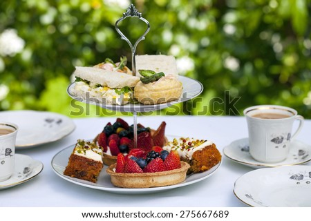 Traditional afternoon tea in the garden - stock photo