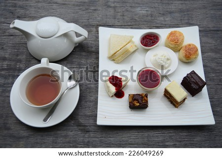 Traditional afternoon tea set on wooden table - stock photo