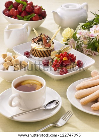traditional afternoon tea setting - stock photo