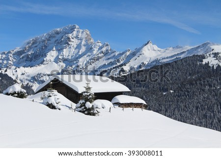 Traditional alpine cabin in the mountains of the Swiss Alps, Switzerland. - stock photo