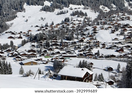 Traditional alpine huts in a snowy, winter setting in the town of Bretaye, Gryon, Switzerland in the Swiss Alps. - stock photo