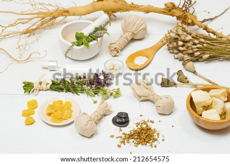 traditional alternative therapy equipments on white wooden table - stock photo