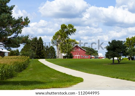 Traditional American Countryside Farm With Cloudy Sky - stock photo