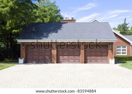 Traditional American Garage With Dark Wooden Door - stock photo