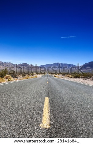 Traditional American Highway Among High Mountains to Death Valley Area. Vertical Image Composition - stock photo