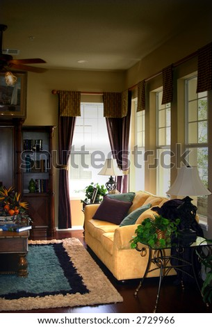 traditional american living room in an upscale home - stock photo