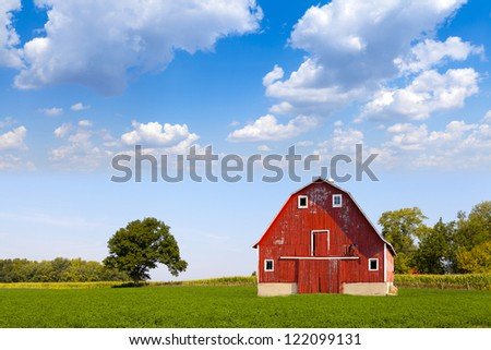 Traditional American Red Barn With Blue Sky - stock photo