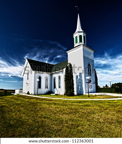 Traditional American white church in the countryside - stock photo