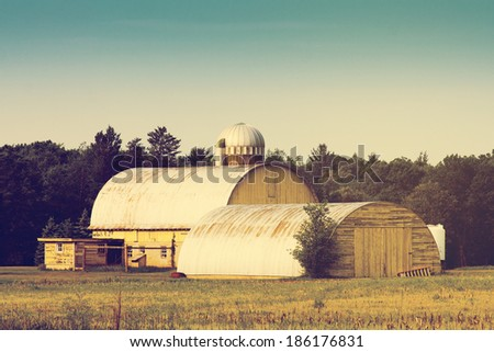 Traditional American Yellow Barn With Blue Sky - stock photo