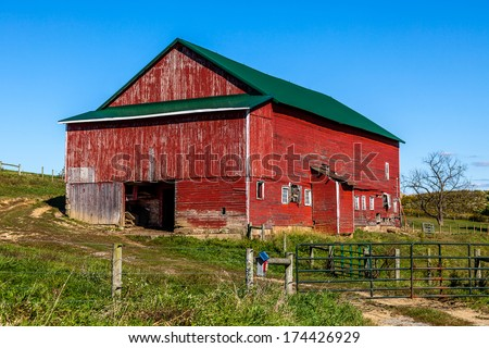 Traditional Amish Barn With Blue Sky - stock photo