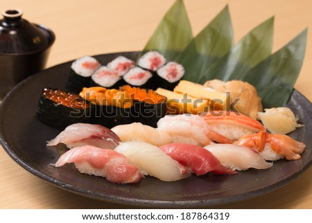 Traditional and authentic Japanese sushi with various kinds of fresh raw fish, Tokyo - stock photo