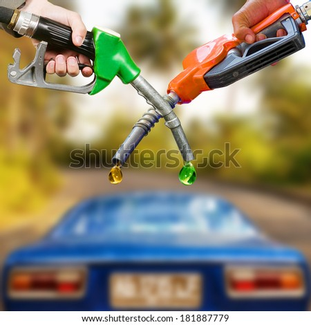 Traditional and ecological fuel competition, photo montage - stock photo