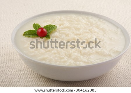 Traditional and tasty  rice pudding. - stock photo