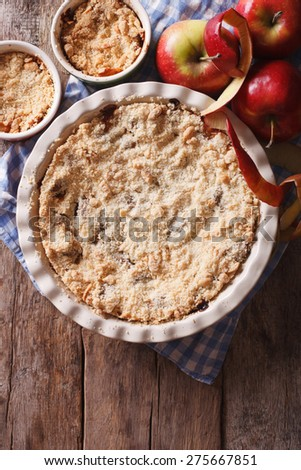 Traditional apple crisp close-up in baking dish. view from above vertical, rustic style