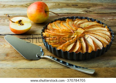 Traditional apple pie, fruit dessert, tart with fresh apples on wooden rustic table, selective focus. Pastry. Dessert. Apple Pie. Apple Tart. Pie. Tart  - stock photo